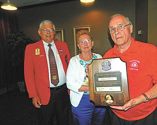 SPECIAL TO THE VINDICATOR: Austintown Lions and Lioness clubs installed officers recently at Rachel's Restaurant in Austintown. King Lion Larry Jensen presided, and the Lions Club marked its 36-year anniversary. Bob Booher, from Canal Fulton Lions Club, served as the installing officer. The highlight of the event was the presentation of the Melvin Jones Fellowship Award to Don Hoelzel for dedicated humanitarian service. From left are Booher, past district governor; June Hoelzel; and Don Hoelzel.