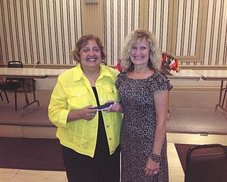 SPECIAL TO THE VINDICATOR:  Nancy Cuffle, right, president of the Youngstown Lions Club, presents Donna Detwiler, vice president of Yellow Brick Place, with a pen for speaking at the Lions' weekly meeting. Detwiler discussed a mission to support and educate cancer patients and those closest to them by providing individual and group services in Mahoning, Trumbull and Columbiana counties. For information email info@yellowbrickplace.org or visit www.yellowbrickplace.org.