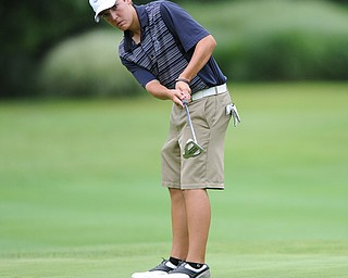 Billy Colbert of Hermitage follows through on his putt on a hole on the back 9 Sunday afternoon at Trumbull Country Club.
