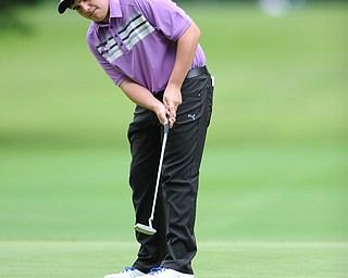 Donavan Ray of Howland follows through on his putt on a hole on the back 9 Sunday afternoon at Trumbull Country Club.