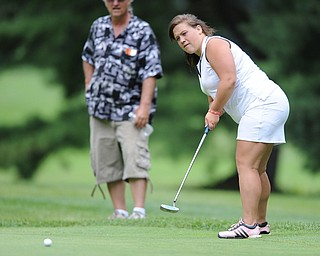 Alexis Cadle follows through on her putt on a hole on the back 9 Sunday afternoon at Trumbull Country Club.