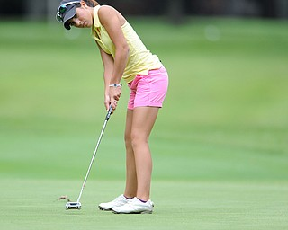 Christina Cooper follows through on her putt on a hole on the back 9 Sunday afternoon at Trumbull Country Club.
