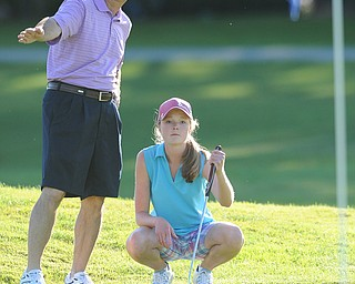 Nadya Stratton gets some help lining up her putt from Jim Stratton on the 18th hole Sunday afternoon at Trumbull Country Club.