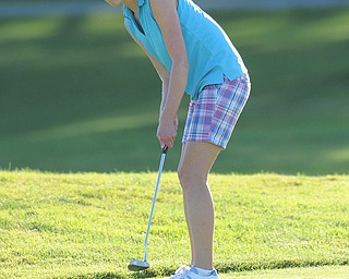 Nadya Stratton follows through on her putt on the 18th hole Sunday afternoon at Trumbull Country Club.