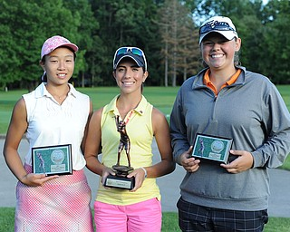 Christina Cooper, center, stands with Jacinta Pikunas, left, and Kaylee Neumeister. Cooper won first place in the Girls 15-17 finals of the 2013 Greatest Golfer of the Valley presented by Farmers National Bank at Trumbull Country Club. Pikunas, the 2011 champ, took second. Neumeister, the 2012 12-14 champ, won third.