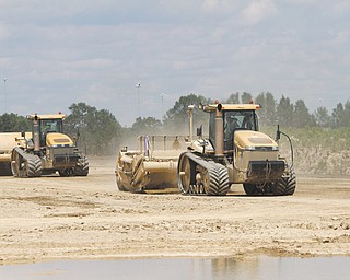 Two excavators work the racetrack, moving dirt from one side of the complex to the other, as Hollywood Slots at Mahoning Valley Race Course begins to take shape. Concrete footers should be started by the end of the week.