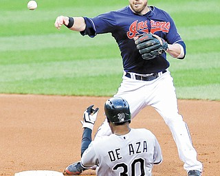 Indians second baseman Jason Kipnis throws to first base as White Sox baserunner Alejandro De Aza slides into second base in the fifth inning Tuesday night in Cleveland. De Aza was out at second base and Alexei Ramirez was out at first base on a double play. The Indians won, 7-4.