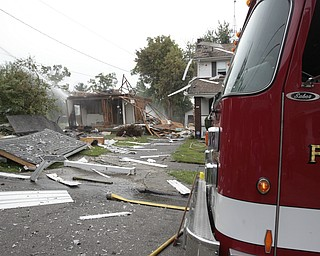 ROBERT K. YOSAY  | THE VINDICATOR  The house at 535 Cohasset Drive was vacant but the house next door at 539 Cohasset is damaged. In addition, at least four homes across the street from the blast had windows that were broken by the force of the explosion.