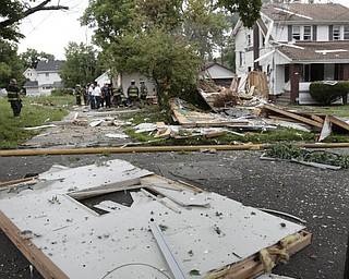 ROBERT K. YOSAY  | THE VINDICATOR  Debris was thrown across the street after the house exploded  The house at 535 Cohasset Drive was vacant but the house next door at 539 Cohasset is damaged. In addition, at least four homes across the street from the blast had windows that were broken by the force of the explosion.