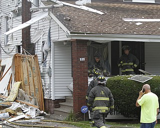 ROBERT K. YOSAY  | THE VINDICATOR  firefighters check out the house next door to the explosion  The house at 535 Cohasset Drive was vacant but the house next door at 539 Cohasset is damaged. In addition, at least four homes across the street from the blast had windows that were broken by the force of the explosion.