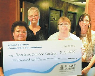 SPECIAL TO THE VINDICATOR Home Savings Charitable Foundation has donated $5,000 to the American Cancer Society. The funds helped to defray the expense of the Ladies Pink Ribbon Golf Tournament, which took place July 15 at Squaw Creek Country Club. From left are Kathy Antonelli, executive assistant at Home Savings; Patty Barber, event honoree, retirement distribution, Home Savings; Cheryl Miskell, 2013 event chairwoman; and Pamela Berry, director of Home Savings Charitable Foundation.