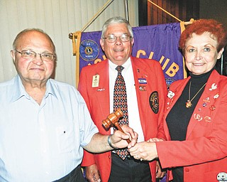SPECIAL TO THE VINDICATOR Lions and Lioness clubs of Austintown conducted their installation of officers recently at Rachel's Restaurant in Austintown. Presiding was King Lion Larry Jensen. Past District Governor Bob Booher, from Canal Fulton Lions Club, served as the installing officer and presented Donald Hoelzel with the Melvin Jones Fellowship Award. From left are Bill Sywy, incoming president; Booher; and Lori Stone, incoming Lioness president. Other Lions officers are Bob Melcher, first vice president; Jack Kochansky, second vice president; Harold Wilson, secretary; Jensen, treasurer and Lioness liaison; Jim Banyots, tail twister; Hoelzel, lion tamer; Bob Whited, membership director and public relations; Glenn Ringer, two-year director; and John Facemyer, one-year director. Lioness officers include Lou Skerkavich, vice president; Teresa McCallen, secretary; and Jane Grace, treasurer. Melcher also was honored as Lion of the Year.