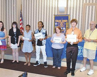SPECIAL TO THE VINDICATOR Kiwanis Club of Youngstown awarded scholarships July 12 to six college-bound students from the area. Each received $500. Five will attend Youngstown State University, and all earned grade-point averages of 3.5 or higher. Financial need also was a consideration. Winners, from left, were Marina Bermann of Ursuline High School, Megan Christ of Chaney STEM/VPA, LaTieya Richard of Cardinal Mooney, LaJuan Thomas of East, Allie Klumpp of Youngstown Christian (accepted by her mother), and Travis Filicky of Boardman. Tom Eisenbraun, Kiwanis member and chairman of the scholarship committee is at the far right, and in the background is Gary Winslow, Kiwanis president.