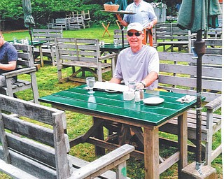 Brenda Williams of Canfield sent this picture of her husband, Bob. The couple were enjoying lunch at Jordan Pond House overlooking Jordan Pond in Acadia National Park this June.