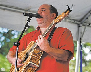 Jay Sylvester sings and plays guitar in the band Lords of Leisure during the Yell for the Well music festival. The festival was held at St. Michael's Catholic Church in Canfield Sunday to raise money toward building a water well in Haiti. The event was created by Nick Crescimanno for his Eagle Scout service project for Troop 115 and featured seven different local bands, fair food, kids games and a bucket auction.