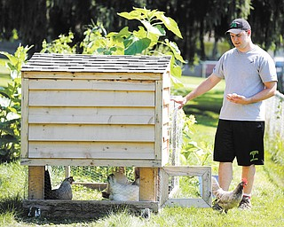 Michael Horst hosts a World Wide Opportunities on Organic Farms at his home in July in Toledo. With thousands of farms in more than 50 countries, WWOOF offers penniless college students, adventurous wayfarers and farming enthusiasts an economical gateway to travel around the globe and an opportunity to learn about organic agriculture.