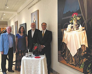 SPECIAL TO THE VINDICATOR Planning the Butler's Aug. 24 Art of Wine event are, left to right, Dan Tidrick, Butler board president; Renée Sheakoski, museum gift shop manager; Vincent Bacon, Butler trustee; and Tom Cavalier, managing director of Stifel Nicolaus.