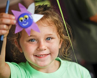 MADELYN P. HASTINGS | THE VINDICATOR..Savannah Cervone, 5, shows off a craft she made at the Austintown National Night Out in the Austintown Township Park on August 6, 2013. This is the first year Austintown participated in the National Night Out hosted by the police department and the trustees. ... - -30-..