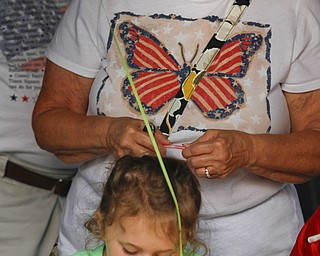 MADELYN P. HASTINGS | THE VINDICATOR..Diane Barnett of Austintown watches her granddaughter Savannah Cervone, 5, make a craft at the Austintown National Night Out in the Austintown Township Park on August 6, 2013. This is the first year Austintown participated in the National Night Out hosted by the police department and the trustees. .... - -30-..