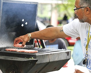 MADELYN P. HASTINGS | THE VINDICATOR..Rick Alli grills burgers at the Youngstown National Night Out at Wick Park on August 6, 2013. This is part of National Night Out program, dedicated to the development and promotion of various crime-prevention programs including neighborhood watch groups, law enforcement agencies, state and regional crime prevention associations, businesses, civic groups, and individuals, devoted to safer communities.... - -30-..