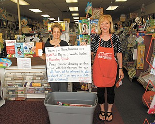 Carole Nicholl, left, who retired last year after 30 years in Warren City Schools, will travel at the end of this month to Moore, Okla., the site of May 20 tornadoes that killed 23 people, to deliver school supplies. With her is Sharon Blumetal of The Supply Room in Liberty, which sells school supplies, and is participating in the project by providing teachers with a $25 gift certificate to use in their own classrooms as an incentive for them to donate items.