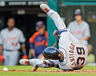 The Tigers' Ramon Santiago falls to the ground after being hit by a pitch by Indians starting pitcher Justin Masterson in the fifth inning of Tuesday's baseball game in Cleveland. Cleveland fell 5-1.