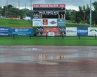 Water pools on the field during a downpour at Firestone Stadium in Akron.