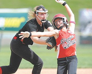 Canfield third baseman Maddy Johns tags out Elyria East's Macy Taylor during a 13-14 Junior League Softball semifinal Tuesday at Firestone Stadium in Akron. Taylor was advanced to third base after officials ruled Canfield's shortstop was in the baseline. Canfield won 9-2 to remain undefeated and advance to the final today against South Portage, Mich.