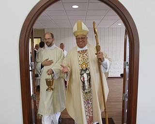 ROBERT K. YOSAY  | THE VINDICATOR  Bishop Murry and Deacon John Ettinger  bless the entrance    St Dominic's New Parish Center  was officially opened today on Southern Blvd. It coincided with the 90th birthday of the church and presided over by Bishop george  Murry
