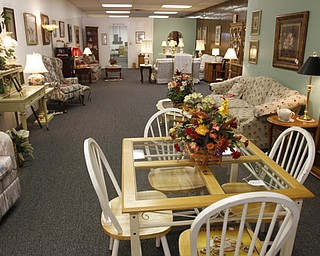 ROBERT K. YOSAY  | THE VINDICATOR..the furniture room..Larry and Ann Canale have been running an antiques business for more than five years. Their operation started from a small house in Columbiana, but has since expanded to a storefront there with 6,000 square feet. A feature on their business and how theyÕve managed to grow.--AnnÕs Attic Antiques & Furniture,  Columbiana.... - -30-..