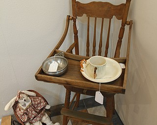 ROBERT K. YOSAY  | THE VINDICATOR..an antique high chair and bowl..Larry and Ann Canale have been running an antiques business for more than five years. Their operation started from a small house in Columbiana, but has since expanded to a storefront there with 6,000 square feet. A feature on their business and how theyÕve managed to grow.--AnnÕs Attic Antiques & Furniture,  Columbiana.... - -30-..