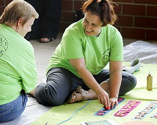 MADELYN P. HASTINGS | THE VINDICATOR..(L-R) Jenifer Edwards and Suzy Mickler design their banner on behalf of Children's Services during the Community Cup banner competition at the Central YMCA in downtown Youngstown on Friday, August 9, 2013.... - -30-..
