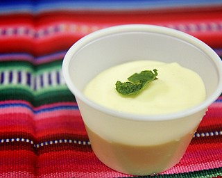 MADELYN P. HASTINGS | THE VINDICATOR..A dish of passionfruit mousse is one of the many varieties of International Latino foods served at the 2nd Annual International Latino Food Fest at the OCCHA Social Hall in Youngstown on Friday, August 9, 2013. ... - -30-..