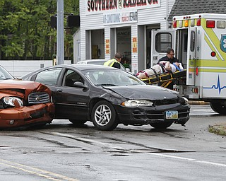 ROBERT K. YOSAY  | THE VINDICATOR..a two car wreck friday morning at Southern Blvd and Midlothian sent two people to the hospital- YPD investiatged ... - -30-..