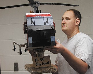 ROBERT K. YOSAY | THE VINDICATOR: Logan, a client at Gateways to Better Living Inc., has a special knack for building models out of cardboard. He is displaying his H-60 Jayhawk helicopter replica.