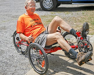 MADELYN P. HASTINGS | THE VINDICATOR..Owner of Rail to Trail adult tricycle store in Lisbon, Wayne Wallace, rides one of his tricycles in the parking lot of his store. The store in No. 1 in the world for sales of the Catrike tricycles. ... - -30-..