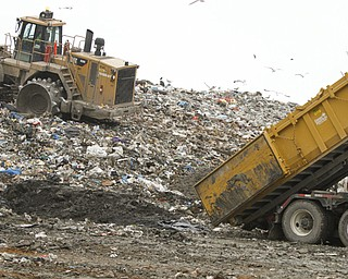 ROBERT K. YOSAY  | THE VINDICATOR..mud from a drilling ste is dumped into the landfill to mbe mixed  with the garbage and fill..Mike Heher, landfill manager-.. tanker trucks dumping the oil and gas drilling mud into the landfill. .. Because of the local drilling boom, landfill  expect a drilling waste dumping bonanza here soon. This landfill can take rock waste from drill cuttings and drilling mud, but not brine or radioactive waste.... - -30-..