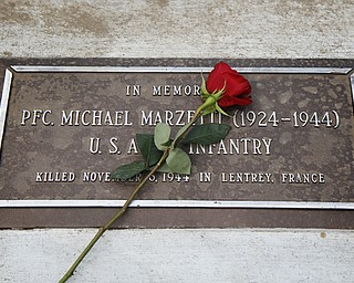 MADELYN P. HASTINGS | THE VINDICATOR..The plaque of PFC. Michael Marzetti, who died on November 5, 1944 in Lentrey, France. A rededication of 17 plaques honoring local veterans who died in combat during World War II and the Vietnam War was part of Lowellville Day on Saturday, August 10, 2013 in downtown Lowellville.... - -30-..