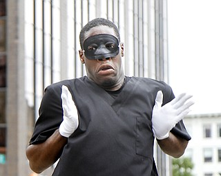 MADELYN P. HASTINGS | THE VINDICATOR..Michael Cotton performs with the group New Bethel Church Mime Ministry during the ÒLetÕs MoveÓ block party in downtown Youngstown on Saturday, August 10, 2013. The block party was a health-oriented activity, from 10 a.m. to 5 p.m. focused on Michelle ObamaÕs project of physical activity Ñ ÒLetÕs Move.Ó The party featured zumba, line dancing, basketball and an obstacle course. ... - -30-..