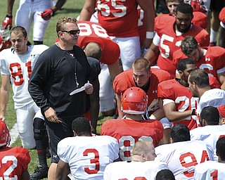Head coach Eric Wolford speaks to his players immediately following the conclusion of practice during a scrimmage on August 10, 2013.