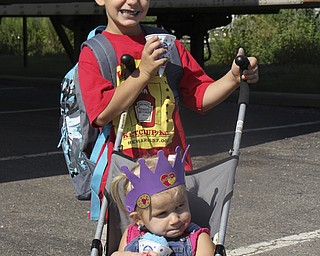 Timothy Baker (6) of Warren pushed his sister, Nevaeh Baker (2), in a stroller while getting Snocones and school supplies during the Goodness Invasion at the Covlli Centre on Saturday Morning.  Dustin Livesay  |  The Vindicator  8/10/13  Covelli Centre.