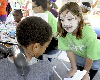 Madison Puckett (10,right) of East Palestine talks to Da'Wan Williams (7) of Youngstown about different styles of face paintings he could get done during the Goodness Invasion at the Covlli Centre on Saturday Morning.  Dustin Livesay  |  The Vindicator  8/10/13  Covelli Centre.