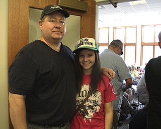 Brian Seese (left) of Columbiana stands with his niece Rachal Lavander (17) of New Middletown during a Big Foot Research Group meeting at the Leetonia Community Public Library in Leetonia on Saturday Morning.  Dustin Livesay  |  The Vindicator  8/10/13  Leetonia Community Public Library..