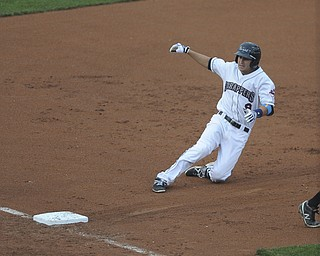 Scrappers #9 Paul Hendrix slides into third base after hitting a two RBI triple in the bottom of the 1st inning during a game between the Scrappers and Renegades on August 10, 2013.