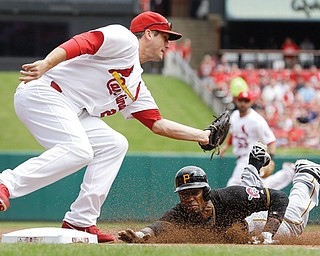 Cardinals third baseman David Freese prepares to tag out the Pirates' Starling Marte on a steal attempt during the first inning of Thursday's baseball game in St. Louis. The game was tied 5-5 until the 12th when Matt Holliday hit a walk-off single to score Matt Carpenter and lift the Cardinals over the Pirates, 6-5.