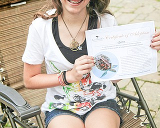 MADELYN P. HASTINGS | THE VINDICATOR  11-year-old Quinn Barton of Poland saves up her allowance to adopt sea turtles and help them with medical issues.