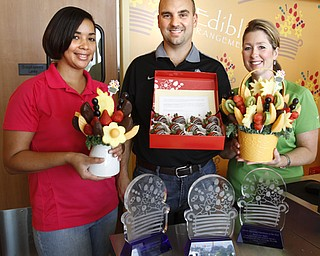 ROBERT K. YOSAY  | THE VINDICATOR  Edible Arrangements. of Boardman and Hermitage - The manager Shakera Brown (red sweater) at the store was just named manager of the year for the entire chain- Ron and Lori   Taylor were named franchise owners of the year.