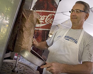Kelli Cardinal/The Vindicator Greg Giannios, from Boardman, shaves gyro meat Saturday during a traditional Greek Festival at St. John's Greek Orthodox Church on Glenwood Avenue in Boardman.  The festival offers many Greek style foods including, lamb sandwiches and stuffed grape leaves.