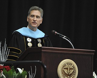 Youngstown State president Randy Dunn gives the opening remarks during the summer commencement ceremony Saturday morning at Beeghley Center.