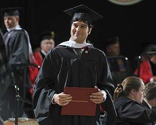 Ryan Antonucci smiles walking off the stage after receiving his masters degree during the summer commencement ceremony Saturday morning at Beeghley Center.